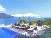 ocean, pool and sunloungers